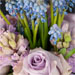 bouquet of lavender roses, lavender hyacinths, blue muscari and scented geranium leaves